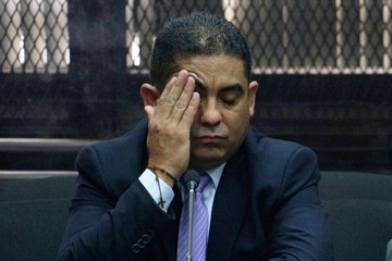Monzon Rojas, former private aide of former VP Baldetti, gestures during a court hearing at the Supreme Court in Guatemala City