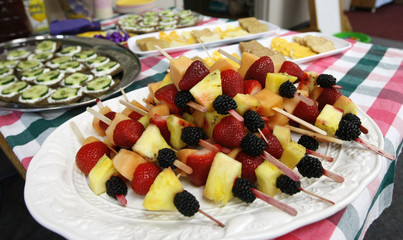The food at the Lookout Mountain Preschool including fruit kabobs are readied for a healthy school party for Mother's Day in Golden