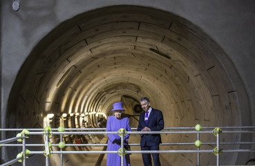Britain's Queen Elizabeth and Mike Brown the London transport commissioner attend the formal unveiling of the new logo for Crossrail, which is to be named the Elizabeth line, at the construction site of the Bond Street station in central London