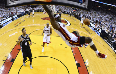 Heat's James dunks on Spurs' Green during Game 2 of the NBA Finals in Miami