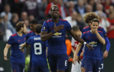 Manchester United's Paul Pogba celebrates scoring their first goal with team mates
