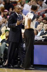 Atlanta Hawks head coach Larry Drew argues with official Eric Lewis during NBA basketball game against Miami Heat in Miami