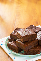 Chocolate Brownies Piled High on a Plate