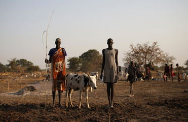 A young man and woman from Dinka tribe stand in a Dinka cattle herders camp near Rumbek