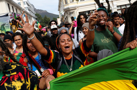 A protester carries a marijuana pipe during a march calling for the legalisation on cannabis in Cape Town, South Africa