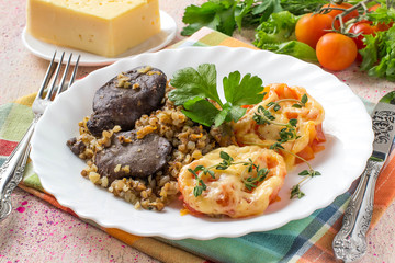 Buckwheat with stewed chicken liver and tomatoes baked with cheese
