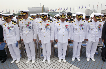 South Korean Navy sailors pay a silent tribute for the fallen sailors from the South Korean Navy's Chamsuri class patrol boat No. 357 during a ceremony in Seoul