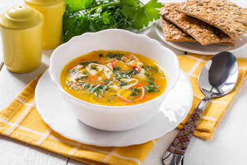 Surimi soup with potatoes, carrots, onions and herbs