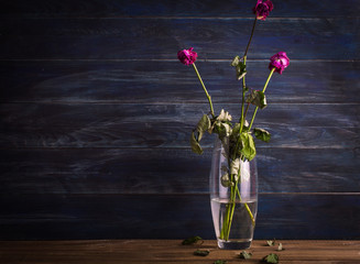 Withered flowers on a wooden background