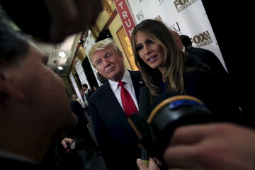 Republican Presidential candidates Donald Trump takes interviews in the spin room after the debate held by Fox Business Network for the top 2016 U.S. Republican candidates