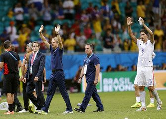 U.S national soccer players wave to the crowd at the end of extra time in the 2014 World Cup round of 16 game between Belgium and the U.S. at the Fonte Nova arena