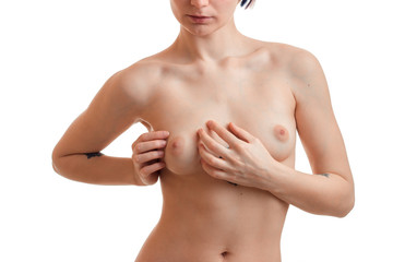 young naked girl checks her hands chest breast cancer close-up