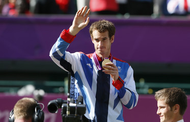 Britain's Murray holds his gold medal during the presentation ceremony after winning the men's singles tennis gold medal match against Switzerland's Federer at the All England Lawn Tennis Club during the London 2012 Olympic Games