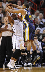 Miami Heat's Wade is defended by Utah Jazz's Watson during the first half of their NBA basketball game in Miami