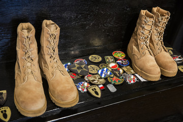 Patches left by U.S. and other ISAF member country soldiers are seen on a step after a memorial for Specialist Wyatt Martin and Sergeant First Class Ramon Morris at Bagram Air Field in the Parwan province of Afghanistan