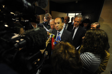 French Labour Minister Eric Woerth speaks to the media after a parliamentary committee meeting about pension reform at the National Assembly in Paris