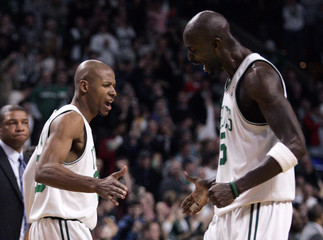 Celtics guard Allen celebrates with teammate Garnett after hitting the go ahead basket against the Wizards late in fourth quarter action during their NBA Basketball game in Boston
