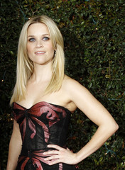 "Witherspoon poses at the premiere of ""How Do You Know"" at the Mann Village theatre in Los Angeles"