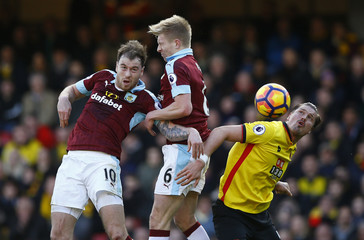 Burnley's Ashley Barnes and Ben Mee in action with Watford's Sebastian Prodl
