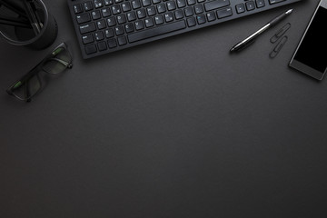 Computer Keyboard With Eyeglasses And Office Supply On Gray Desk Wall mural