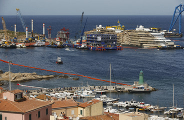 """The cruise liner Costa Concordia is seen at the end of the """"parbuckling"""" operation outside Giglio harbour"""