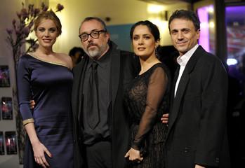 "Director Alex de la Iglesia poses with cast members Salma Hayek, Carolina Herrera Bang and Jose Mota as they arrive for the screening of the movie ""La Chispa de la Vida"" in Berlin"
