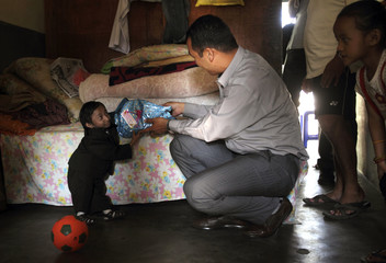 Khagendra Thapa receives a birthday gift at his rented house in Pokhara, west Nepal