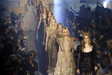 Models present creations by Lebanese designer Elie Saab as part of his Haute Couture Fall Winter 2015/2016 fashion show in Paris, France