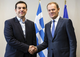 Greek PM Tsipras poses with European Council President Tusk ahead of a meeting at the EU Council in Brussels