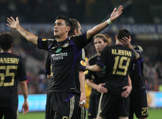 Suarez celebrates after scoring against AEK Athens during their Europa League soccer match in Brussels