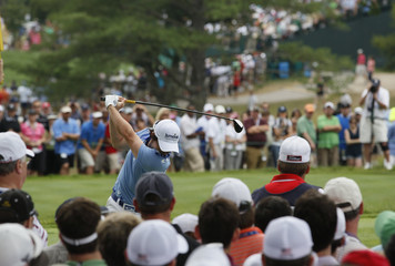 McIlroy tees off on the fourth hole during the final round of the 2011 U.S. Open