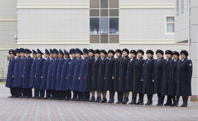 """Kazakhstan's railway staff line up to welcome foreign diplomats touring the International Centre of Boundary Cooperation """"Khorgos"""" at a border with China, Kazakhstan"""