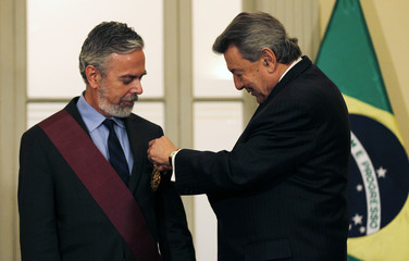 "Peru's Foreign Minister Roncagliolo decorates his Brazilian counterpart Patriota with the ""Orden Del Sol"" medal during a meeting at the Foreign Ministry in Lima"