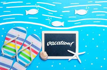 sandals, blackboard, toys, seashell and seafish