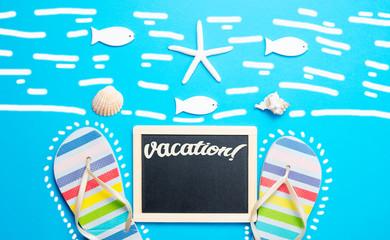 blackboard, seashells, starfish, sandals and toys