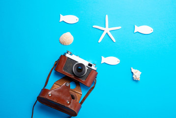 camera, seashells, starfish and toys