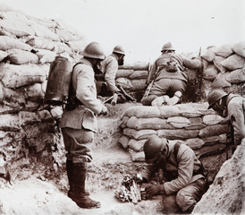 An undated archive picture shows French soldiers wearing gas masks in a trench during an alert on the front line, unknown location in France