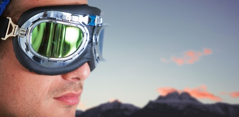 Composite image of close up of man wearing aviator goggles