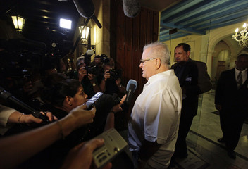 Cuban dissident Elizardo Sanchez speaks to reporters before a meeting with former U.S. President Jimmy Carter in Havana