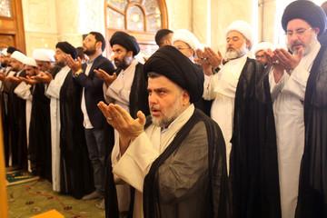 Iraqi Shi'ite radical leader Moqtada al-Sadr takes part in Friday prayers at the Kufa mosque near Najaf