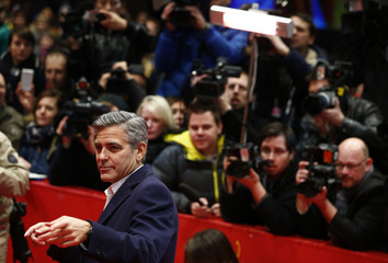 Cast member and director Clooney arrives for screening at 64th Berlinale International Film Festival in Berlin