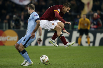 AS Roma's Totti is challenged by Manchester City's Zabaleta during their Champions League Group E soccer match at the Olympic stadium in Rome
