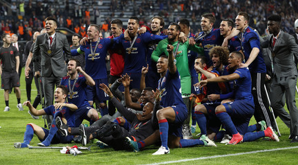 Manchester United celebrate with the trophy after winning the Europa League