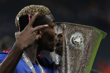 Manchester United's Paul Pogba celebrates with the trophy after winning the Europa League