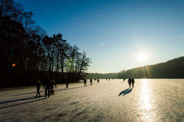 Ice-skating on a sunny day, Schlachtensee, Berlin, Germany