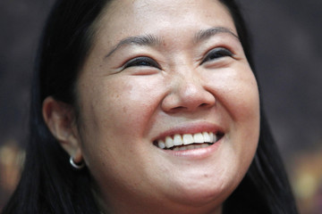 Presidential candidate Keiko Fujimori laughs during a meeting with young members of her party in Lim