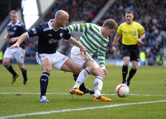 Raith Rovers' Simon Mensing challenges Celtic's Kris Commons and concedes a penalty during their Scottish FA Cup soccer match at Stark's Park Stadium in Kirkcaldy