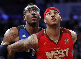 East All Star Stoudamire of the Knicks and West All Star Anthony of the Nuggets look for a rebound during the NBA All-Star basketball game in Los Angeles