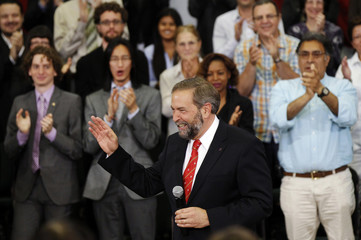 Canada's New Democratic Party leader Mulcair speaks to caucus staff during an event in Ottawa