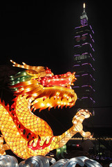 A dragon-shaped lantern is on display in front of Taiwan's landmark building Taipei 101 during Lantern Festival celebrations